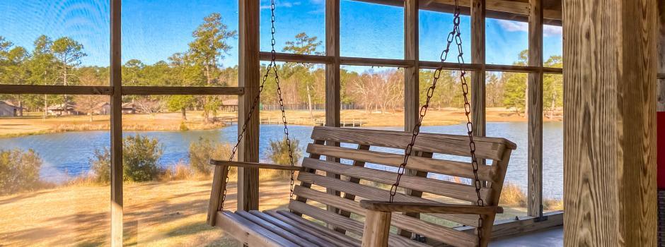 Coastal Cabin Rental, porch swing